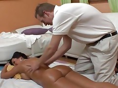 An oiled up stripped Lisa Ann receives an after massage fuck