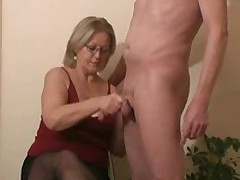 This cutie next door doesn't like to show herself, but that babe likes for her ally next door to show himself.  While this guy is nude, that babe jerks him until this guy cums allover her darksome stockings.
