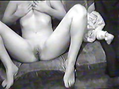 Hawt black-and-white home movie scene with breasty dark brown doing a blowjob on her boy-friend's pecker and riding it in reverse position.