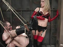 Watch this super sexy blonde mama teaching this bad boy a lesson in hard way. This babe bound him up and gagged his face hole before fucking his world upside down! This babe puts on a thong on and fucks him real hard. This babe also locked his cock so that this guy can't cum! This babe keeps teasing his cock and fucking his wazoo with pleasure!