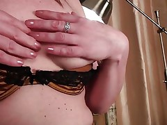 Pretty golden-haired mature Louise begins stripping herself and touching her wet cunt. This babe discloses a gorgeous golden underware and plays with her nylons a little to turn u on. This babe widens her legs and shows off her pussy, then moves back to her titties and tickles them a little. What will she do next?