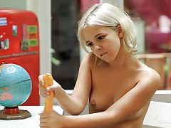 Blonde honey has a hawt body and unquenchable thirst for raunchy pleasure. She is sitting topless in the study and trying to please herself with her dildo toy. As she keeps thinking about a cock with holding that dildo in her hands, her nipples get harder. And she starts sucking it and rubbing it in her twat!