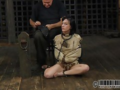 Sexy brunette Elise is all bound up and shackled and sits obedient on the floor near to her executor who puts a mask on her face. This guy explains this s&m technique and what this honey is supposed to do. The bitch enjoys being the center of attention and waits for her bondage treatment. Wanna see what happens to her?