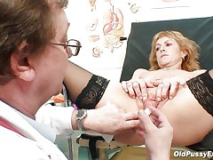 Older blonde Nora is a floozy with big boobs and large hairless vagina that is examined by a gynecologist. The doctor uses a metal speculum and gapes her pussy so we can see inside it. This floozy seems to be healthy and her pussy is now willing for a hard fuck.