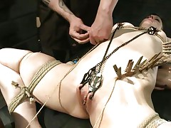 Katharine Cane is a breasty brunette milf desperately in need for punishment. Watch how Soma Snakeoil and her male friend give her what this hottie wants. The hot red haired hottie and her help are putting clothespins all over her body, making her scream with pleasure and ache while rubbing her pussy with a large vibrator.