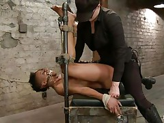With her feet fastened up and metal clamps all over her body the ebon slut endures a harsh punishment. This female-dominant knows what he's doing and gives her both pain and pleasure. She can't even scream as her face hole is folded with scotch tape. Look at that shaved cunt and how deep she's rubbing it with the vibrator.