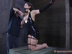 Brunette Marina wearing a dark latex suit and having a large dark ball gagging her face hole is about to be punished by her executor. The man starts with her zeppelins and uses very large suckers to torture 'em and when Marine's nipples are hard he ties 'em with rubber bands. Appears to be that babe will stay there for a long time