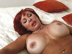 Her years of experience in fucking have a lot to say. Check out this gorgeous redhead milf and how lustfully this chick sucks and bonks cock. Damn the bitch knows how to drink a cock and when this chick goes on top and rides this guy we can clearly watch her wet crack lips spreading. Yep this milf needs some jizz deep inside her