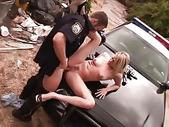Mr. police officer does his job with rigorous attention. He takes of this blonde short panties and starts licking her sexy hips and then her juicy vagina, using all his tongue as he does that. The blonde delinquent receives a hard fingering as a treatment and then he takes out his big hard penis and stuffs her muffin with it. She can't live without it and her nice titties, long sexy legs and concupiscent face will surely make him cum.
