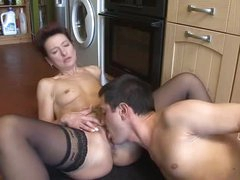 Mature with a pierced tongue kitchen fuck