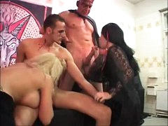 Strange foursome with tattooed and pierced beauties