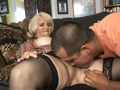 Mature blonde Sophie Mounds with wet pierced snatch